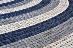 Black, grey and white floor tiles Stock Image