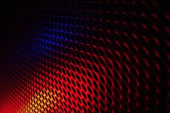 Black grid speaker texture with red and blue colors Royalty Free Stock Image