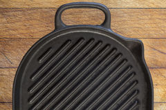 Black grill pan on wood background Stock Images