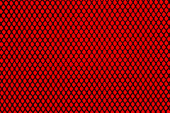 Black grill on red background Royalty Free Stock Images