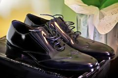 Black groom shoes on the box. Closeup Stock Photos