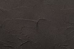 Black grunge concrete or stone texture for background and pattern. Dark gray backdrop with stone structure - closeup surface of cement and sand wall or floor stock photo