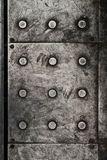 Black grunge metal plate as background Stock Images