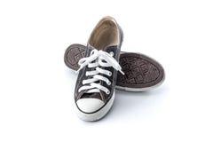Black grunge shoes on white background Royalty Free Stock Image