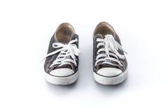 Black grunge shoes on white Stock Images