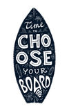 Black grunge surfing board shape with hand-drawn lettering on it. Black grunge surfing board shape with hand-drawn lettering - Time to Choose Your Board Stock Photography