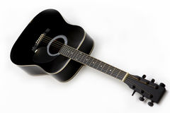 Black guitar. Acoustic guitar isolated over white Royalty Free Stock Photo
