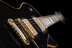Black guitar. Close up of hand made electrical guitar Royalty Free Stock Photography