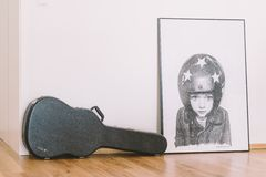 Black Guitar Bag Beside White Concrete Wall Royalty Free Stock Images