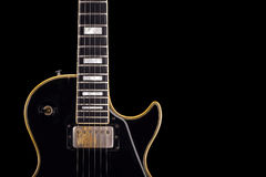 Black guitar. Close up of electric guitar Royalty Free Stock Photo