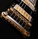 Black guitar. Close up of electric guitar Stock Photography