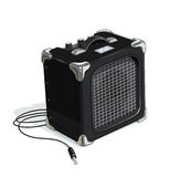 Black guitar combo amplifier with cord Royalty Free Stock Photo