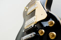 Black guitar model les paul on a white background showing part of the body in a bottom view stock photography
