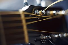 Black guitar neck on a blue background royalty free stock image