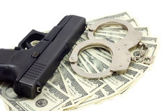 Black gun, bracelets and cash Stock Photos