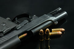 Black gun and bullets Royalty Free Stock Photo