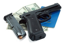 Black gun,  bullets and cash Stock Photo