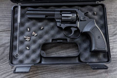 Black gun in a case. Royalty Free Stock Image