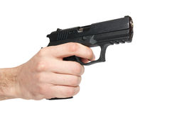 Black gun in a hand Royalty Free Stock Image