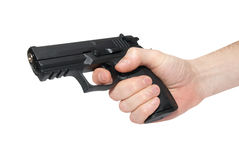 Black gun in a hand Stock Image