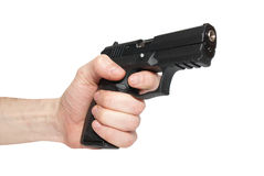 Black gun in a hand Royalty Free Stock Photography
