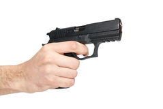 Black gun in a hand Stock Photos