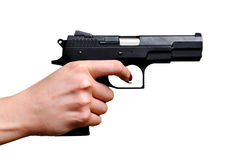 Black gun in a hand. On the white background royalty free stock photo