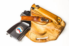 Black gun in a leather holster Royalty Free Stock Photos