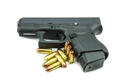 Black gun and 9mm bullets  a white background.  Royalty Free Stock Images