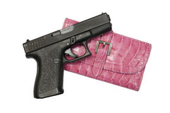 Black Gun and Pink Clutch Hand Bag. Black 9mm Glock with women's pink leather clutch purse Stock Image