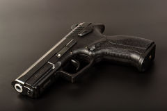 The black gun pistol on a dark background. Close up. Isolate Stock Image