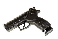 The black gun pistol on a white background close up. Isolate Stock Images