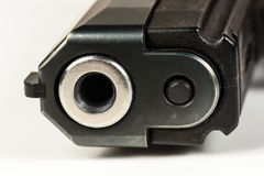 The black gun pistol on a white background close up. Isolate Stock Image