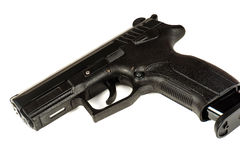 The black gun pistol on a white background close up. Stock Images