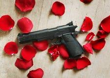 Free Black Gun Red Roses Petals Stock Images - 42997484