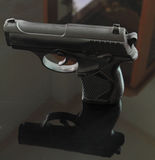 The black gun with the shadow. And the glass Stock Photography