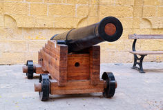 Black ancient cannon on a wooden gun carriage Stock Photography