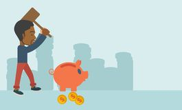 Black guy holding a hammer breaking piggy bank Royalty Free Stock Images