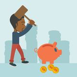 Black guy holding a hammer breaking piggy bank. A black businessman standing while holding a hammer breaking piggy bank with dollar coins for financial Royalty Free Stock Image