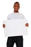 Black guy holding white sign Royalty Free Stock Image