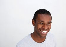 Black guy laughing against white background Royalty Free Stock Photos