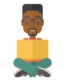 Black guy reading a book Stock Photos