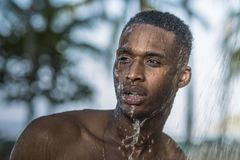 The black guy in the shower in nature Stock Image