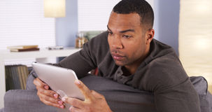 Black guy using tablet Stock Photo