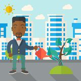 Black guy watering the plant Royalty Free Stock Photo
