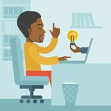 Black guy working inside his office Royalty Free Stock Images