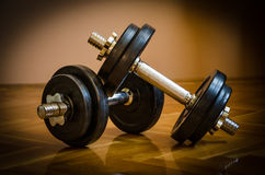 Black gym barbell, dumbbell with disks Stock Photo