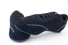 Black gym shoes. On white background Royalty Free Stock Images
