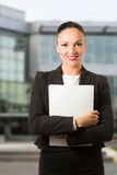 Black hair business dressed woman holding white book Royalty Free Stock Photography