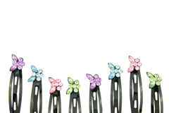 Black hair clip with colorful butterfly put as wave isolated Stock Photos